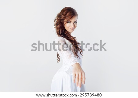 The bride extends her hand, beautiful smiling woman in a wedding dress - stock photo