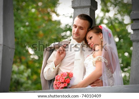 The bride has put a head on a shoulder to the groom - stock photo