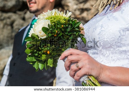 the bride holding a bouquet in his hand on the wedding ceremony - stock photo