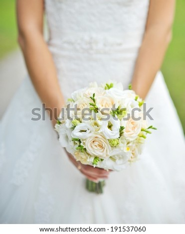 the bride holds a beautiful bouquet