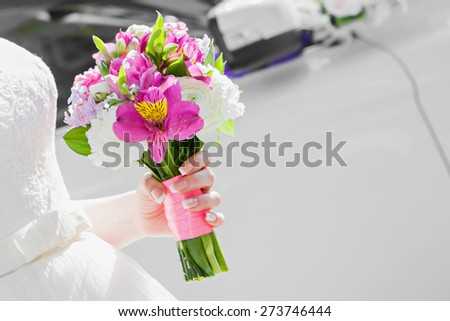 The bride holds the beautiful wedding bouquet