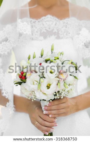 The bride holds the beautiful wedding bouquet - stock photo