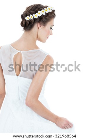 the bride in a wedding dress on a white background - stock photo