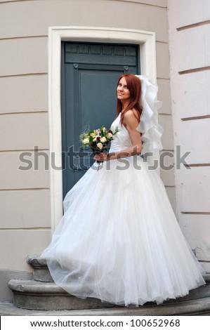 The bride near the church door - stock photo