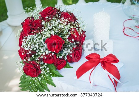 the bride's bouquet, red roses, flower arrangement