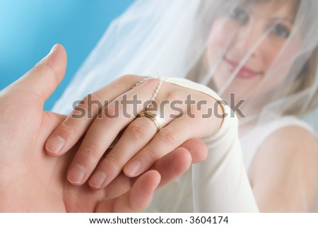 The bride stretches a hand with a ring - stock photo
