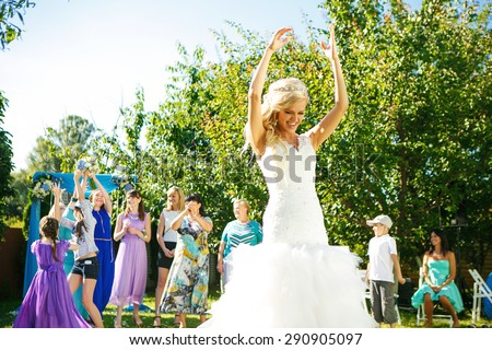 The bride throws a wedding bouquet by themselves