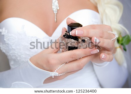 The bride with a bottle of perfume.