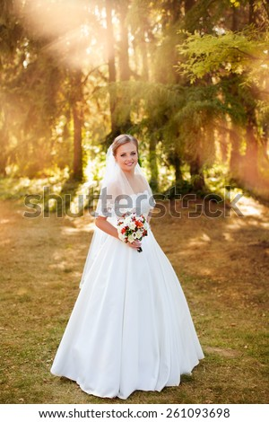 The bride with a bouquet,Portrait of the bride -bride in an expensive wedding dress,pretty personality,madam,Gorgeous bride,a lady      - stock photo