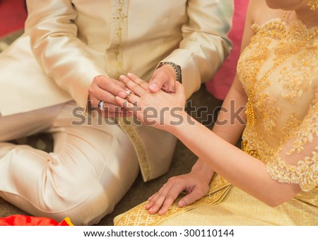 The bride wore a bride groom's wedding ring in traditional wedding ceremony Thailand