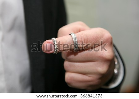 the bride wore two wedding rings on the index finger