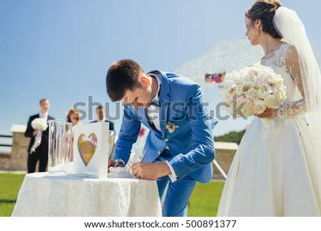 the brides signing certificate of marriage