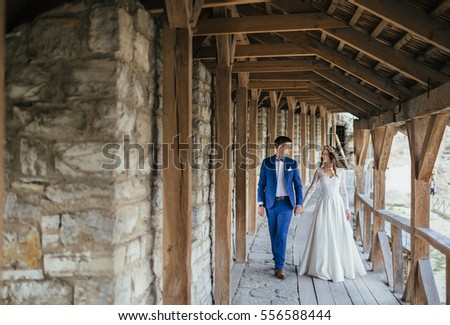 The brides walking through the castle