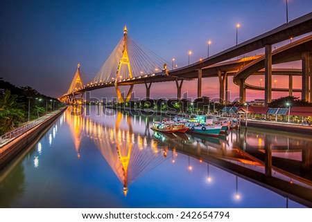 The Bridge across the river at twilight, The Industrail Ring Road (Bangkok, Thailand)  - stock photo