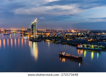 The Bridge across the river with Modern Building at dusk (Bangkok, Thailand) - stock photo