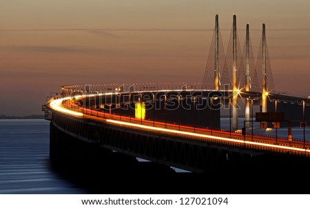 The bridge between Denmark and Sweden during sunset in March - stock photo