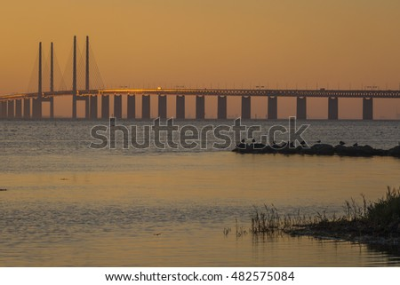 The bridge between Malmo, Sweden and Copenhagen, Denmark, oresund bridge, in late summer sunset in September after a hot day.