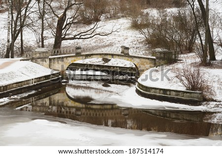 The Bridge Of The Centaurs and Slavjanka river in winter. Pavlovsk Park near Saint Petersburg, Russia