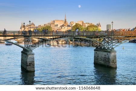 The bridge Pont des Arts or Passerelle des Arts across river Seine in Paris, France. - stock photo