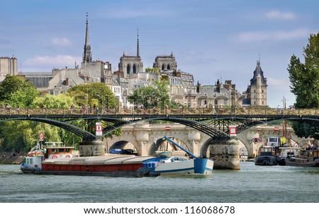 The bridge Pont des Arts or Passerelle des Arts across Seine river in Paris, France. - stock photo