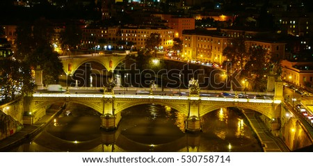 The bridges over River Tiber in Rome - amazing night view - ROME / ITALY, NOVEMBER 6, 2016