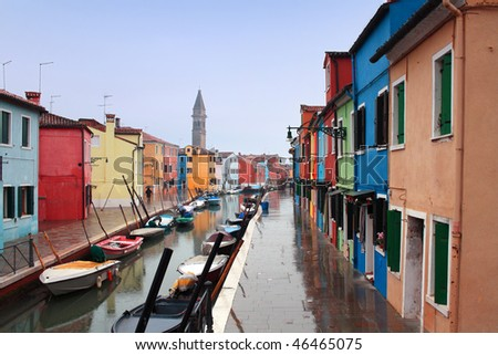 The bright pastel-coloured houses on Burano Island in the north of Venice's lagoon, Italy - stock photo