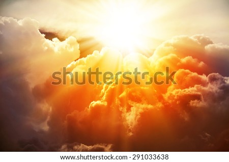 The bright rays of the sun are shining from saturated clouds - stock photo