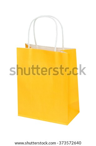 The bright yellow paper package, bag for gifts or purchases isolated on the white