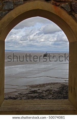 The Bristol Channel and Clevedon Pier viewed through an arched window on a blustery winter's day