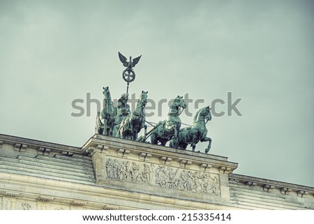 the bronze sculpture Quadriga on top of the Brandenburg Gate, Berlin, Germany, Europe, vintage style, Bronzeskulptur Quadriga auf dem Brandenburger Tor, Berlin, Deutschland - stock photo