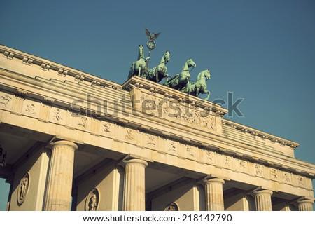 the bronze sculpture Quadriga on top of the Brandenburg Gate, Berlin, Germany, Europe, vintage style - stock photo