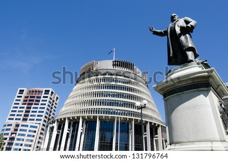 The bronze statue of Richard John Seddon and the Beehive building - Parliament of New Zealand in Wellington city. - stock photo