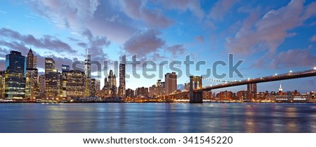 The Brooklyn Bridge and Manhattan skyline as seen from across the East River at dusk. New York City at night