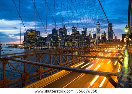 The Brooklyn Bridge and skyline of New York City at sunset - stock photo