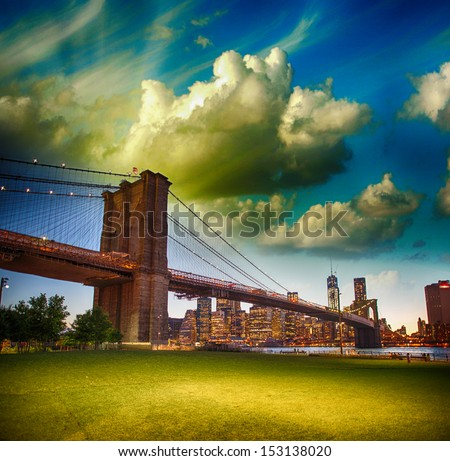 The Brooklyn Bridge as seen from Brooklyn Bridge Park, New York City - Sunset summer view. - stock photo
