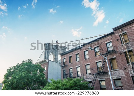 The Brooklyn Bridge at sunset as seen from Brooklyn streets - New York. - stock photo