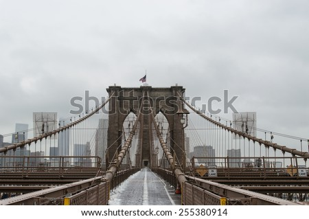 The Brooklyn Bridge connects Manhattan to Brooklyn across the East River and was opened in 1883.