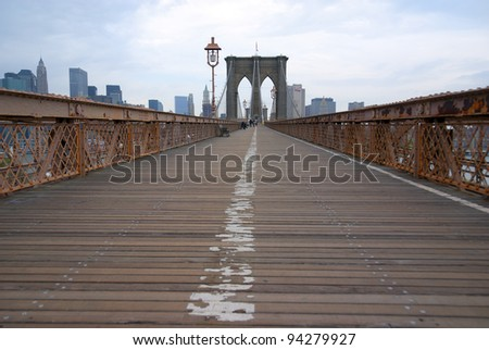 The Brooklyn Bridge is one of the oldest suspension bridges in the United States. Completed in 1883, it connects the New York City boroughs of Manhattan and Brooklyn by spanning the East River.
