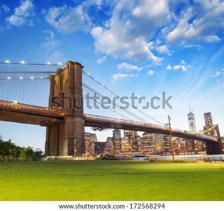 The Brooklyn Bridge, New York. Beautiful colors at summer sunset. - stock photo