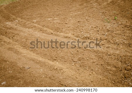 the Brown agricultural soil of a field - stock photo