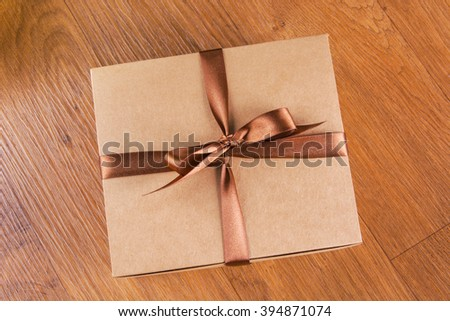 The brown box and brown bowknot - stock photo