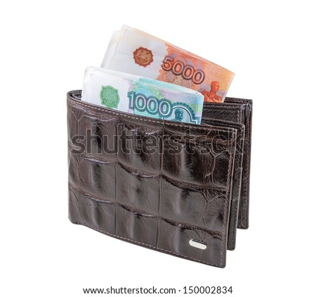 The brown  leather wallet with rubles is photographed on the close-up - stock photo