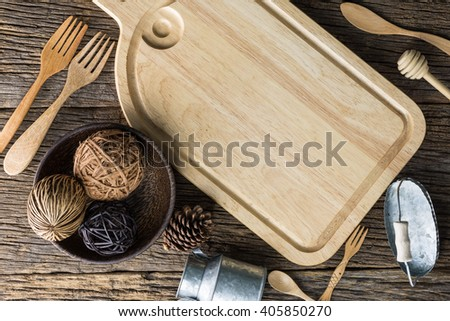 The brown wooden cutting board on a rustic table closeup,wooden background, Top View with Copy Space for Text - stock photo