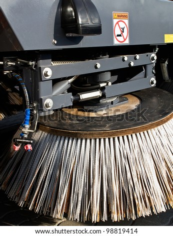 The brush disc of a sweeper truck - stock photo