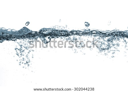 The bubbles are dispersed in water on a white background. - stock photo