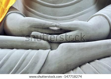 The Buddha are sit cross-legged. - stock photo