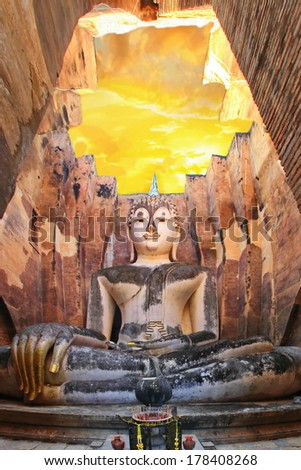 The Buddha status old with golden hand of sukhothai historical park,sukhothai province ,Thailand - stock photo