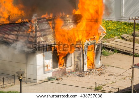 the building fire of all burns in the fire and smoke - stock photo