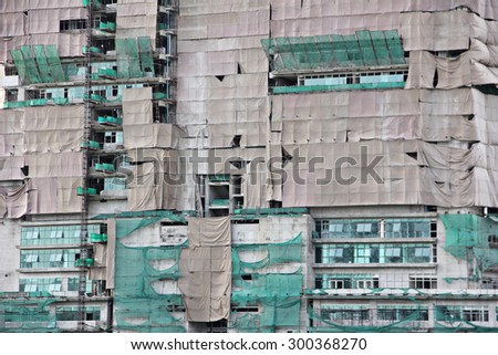 The building was built have canvas covered working - stock photo