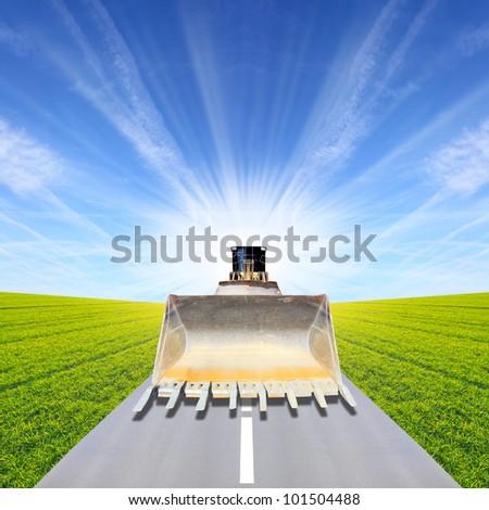 The bulldozer on a road. Under construction concept. - stock photo